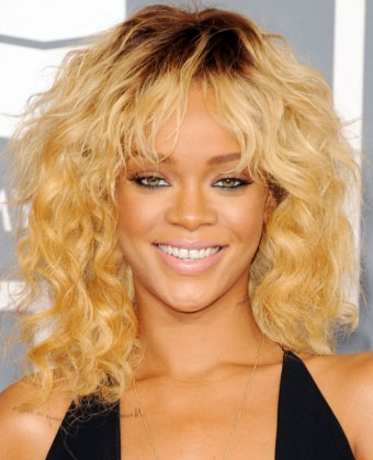 Rihanna's Messy Blonde Curls with Bangs