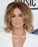 Miley Cyrus' Retro Short Curly Hairstyle with Volume