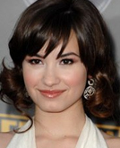 Demi Lovato's Shoulder Length Wavy Hairstyle with Bangs