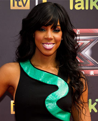 Kelly Rowland looked amazing with her long tresses in tousled curls.