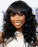 Brandy's Black Wavy Hairstyle with Bangs