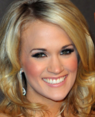 Carrie Underwood's Medium Hairstyle with Waves at 2010 People's Choice Awards