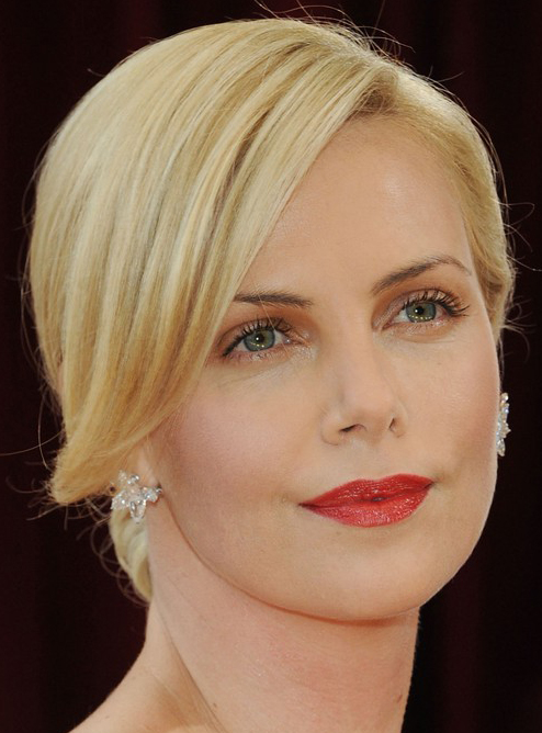 Charlize Theron's Elegant Chignon Hairstyle at 2010 Oscars Red Carpet