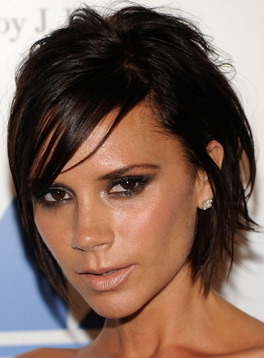 Victoria Beckham wearing messy short haircut and David Beckham support ...