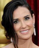 Demi Moore's Deep Side-parted Low Bun Hairstyle at 2010 Oscars Red Carpet