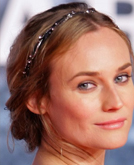 Diane Kruger's Elegant Chignon Hairstyle with Hair Accessories