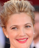 Drew Barrymore's Pulled-back Updo Hairstyle with Bun at Emmy Awards 2009