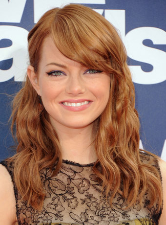 Emma Stone's Red Curly Hairstyle with Bangs