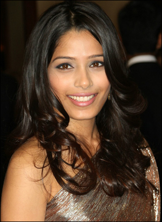 Freida Pinto is wearing her hair in a sexy long hairstyle with round ...