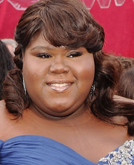 Gabourey Sidibe's Half Up Half Down Hairstyle With Curls at 2010 Oscars Red Carpet