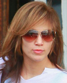 Jennifer Lopez's Long Layered Hairstyle with Bangs