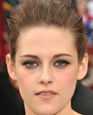 Kristen Stewart's Sleek Back Updo Hairstyle at 2010 Oscars Red Carpet