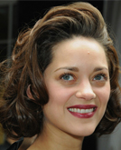 Marion Cotillard's Pulled-back Medium Curly Hairstyle at Dior AD