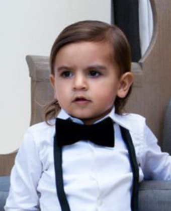 Mason Disick nephew of Kim Kardashian wears a sideparted medium wavy