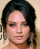 Mila Kunis's Elegant Low Updo Hairstyle with Wave