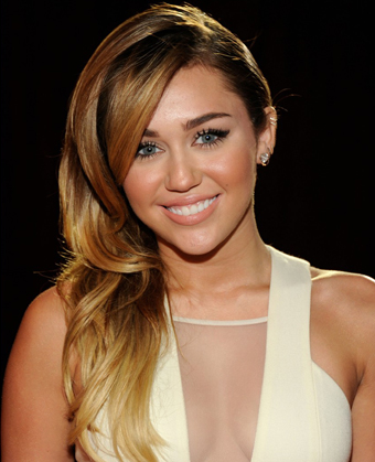 Admirable Miley Cyrus39 Side Swept Curly Hairstyle Short Hairstyles Gunalazisus