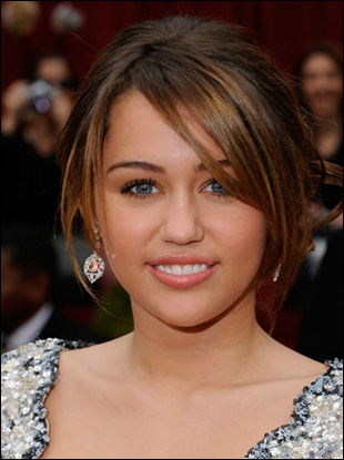 Miley Cyrus Low Bun Hairstyle with Bangs at Oscars 2009
