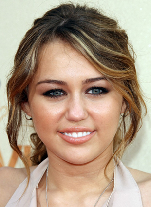 Miley Cyrus Long Curly Hairstyle with Low Ponytail at 2009 MTV Movie Awards