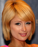 Paris Hilton's Asymmetrical Chin-length Styling with Bangs and Long Spiral Curls
