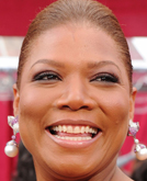 Queen Latifa's Sleek Updo Hairstyle at 2010 Oscars Red Carpet