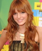 Bella Thorne's Long Reddish Curls with Bangs
