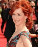 Carrie Preston's Red Wavy Hairstyle