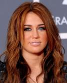 Miley Cyrus's Center-Parted Long Wavy Hairstyle