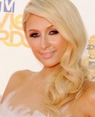 Paris Hilton's Long Side-Parted Wavy Hairstyle