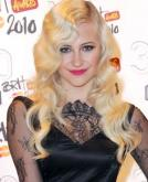 Pixie Lott's Blonde Curly Hairstyle