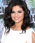 Selena Gomez Deep Side Part Curly Hairstyle