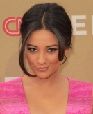 Shay Mitchell's Loose Updo With Face-Framing Strands