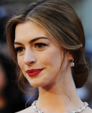 Anne Hathaway's Graceful Chignon with Loose Tendrils