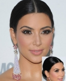 Kim Kardashian's Sleek Center-Parted Low Bun