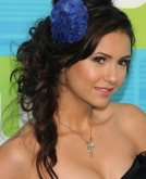 Nina Dobrev's Side-swept Curly Style with Headband