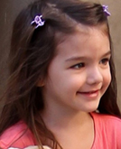 Suri Cruise's French Twist Hairstyle with Pink Clip