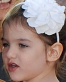 Suri Cruise's White Flower Headband Hairstyle