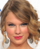 Taylor Swift's Elegant Chignon Hairstyle with Waves at 2010 People's Choice Awards