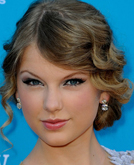 Taylor Swift's Low Bun Hairstyle with Waves at 2010 ACM Awards