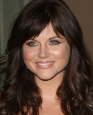 Tiffani Thiessen's Long Wavy Hairstyle with Bangs