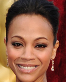Zoe Saldana's Sleek Back Updo Hairstyle at 2010 Oscars Red Carpet