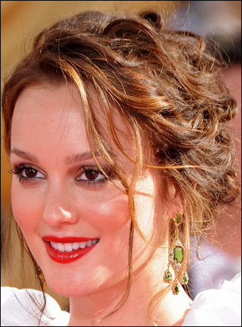 Leighton meester s messy lovely chignon hairstyle with loss braid at